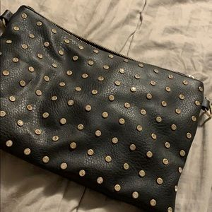 Black clutch or crossbody with straps looks new